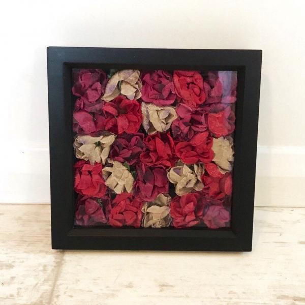 Red roses in a black box frame